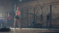 Woman doing tough workout with ropes