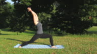 MS Woman doing various Yoga poses in Prospect Park / New York, United States