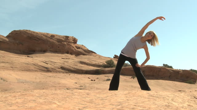 woman doing yoga in the desert