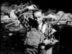B/W Woman drawing painting of fish hunting man, New York / AUDIO
