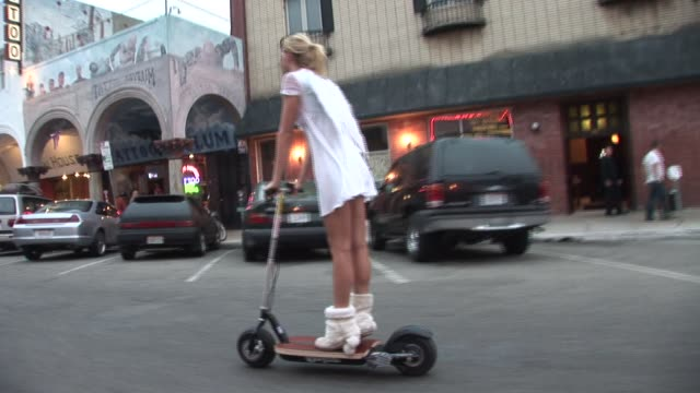 MS TS Woman dressed in angel costume riding motor scooter/ Venice Beach, California