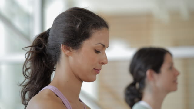 CU TU TD Woman drinking water, taking a break in yoga studio / Vancouver, British Columbia, Canada