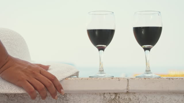 SLO MO Woman drinking wine on the balcony