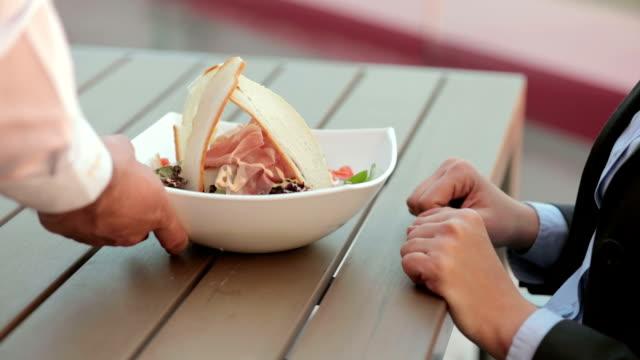Woman eating caesar salad