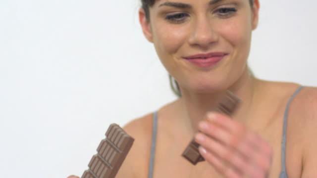 CU TU SLO MO Woman eating chocolate / London, Greater London, United Kingdom