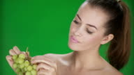 HD: Woman Eating Grape
