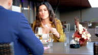 Woman eating in outdoor restaurant