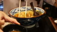 woman eats Korean food