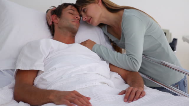 Woman embracing her unconscious husband