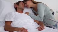 Woman embracing her unconscious husband