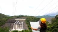 Woman engineer working at dam