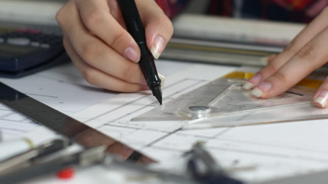 Woman Engineer working with architect construction design blueprints,Architect concept