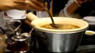 woman enjoy Fish maw soup in bowl