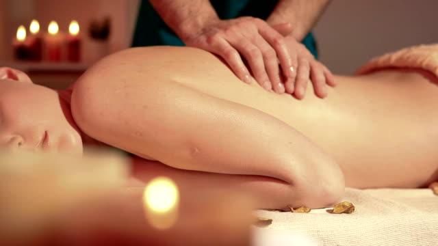 Woman enjoying back massage dolly shot