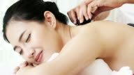 Woman enjoying massage for relaxation.