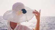SLO MO Woman enjoying the wind while sailing