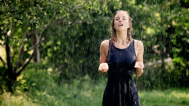 Woman enjoys summer rain