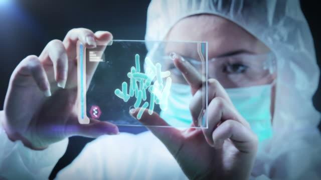 Woman examines sample demo on screen