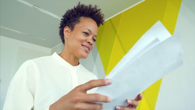 Woman examining documents.