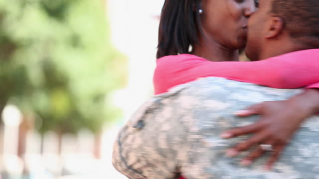 CU Woman Excitedly Hugging Soldier Returning Home from Military Service / Petersburg, Virginia, United States