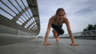 Woman exercising doing climbing planks