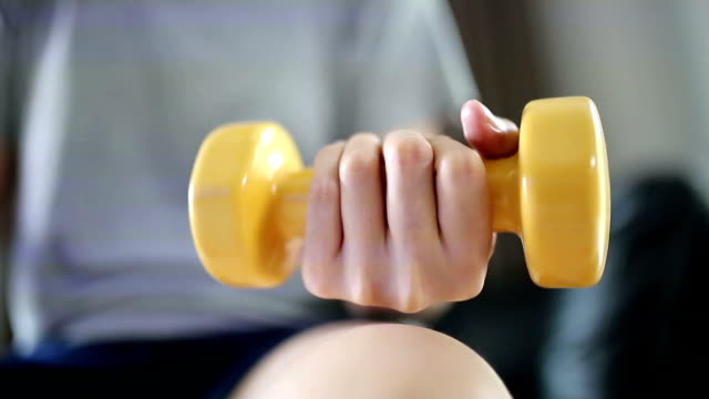 woman exercising with weights.