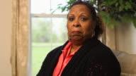 Woman Expresses Sorrow Looking at Camera