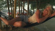 Woman falls asleep in hammock