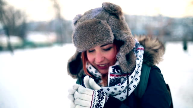 Woman Feeling Cold Warming Hands By Blowing On Them