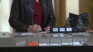 MS TU Woman filling out deposit form, Bethlehem, Pennsylvania, USA