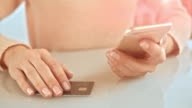 SLO MO woman finalizing credit card purchase over the phone