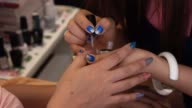 woman fingernail manicure in beauty salon
