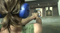 CU Woman firing handgun at target at shooting range/ Las Vegas, Nevada