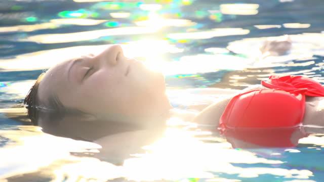HD SLOW MOTION: Woman Floating In Water