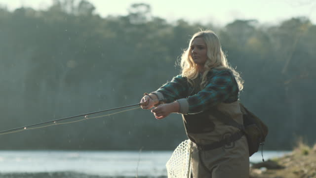 Woman Fly-Fishing on River