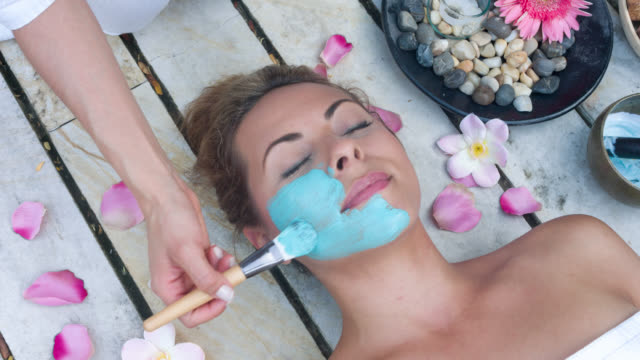 Woman getting a facial at the spa