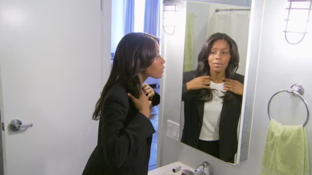 woman getting dressed for work stock footage video getty