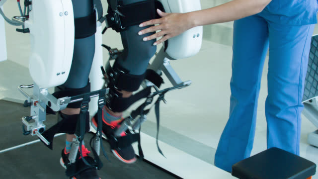 Woman getting physical therapy on a robot machine