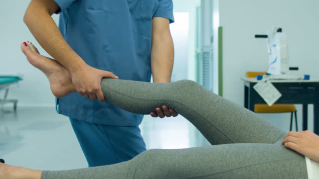 Woman getting physiotherapy for her ankle