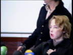 Woman given face transplant makes first public appearance FRANCE Amiens INT Isabelle Dinoire arriving in conference room Dinoire sitting down at...
