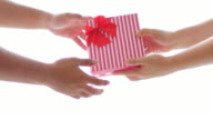 Woman gives a gift box on celebration day