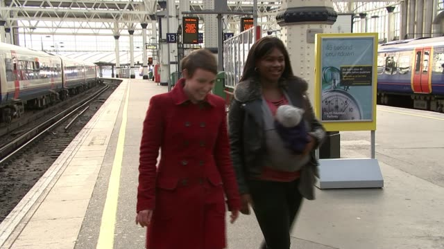 Woman gives birth at Waterloo train station ENGLAND London Waterloo Station INT Baby Reign yawning in mother's arms GVs Mother Evelyn Brandao holding...