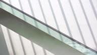 WS woman going up an escalator.