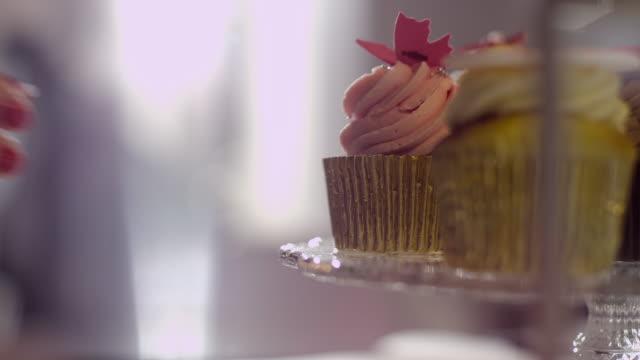 Woman grabbing cupcake
