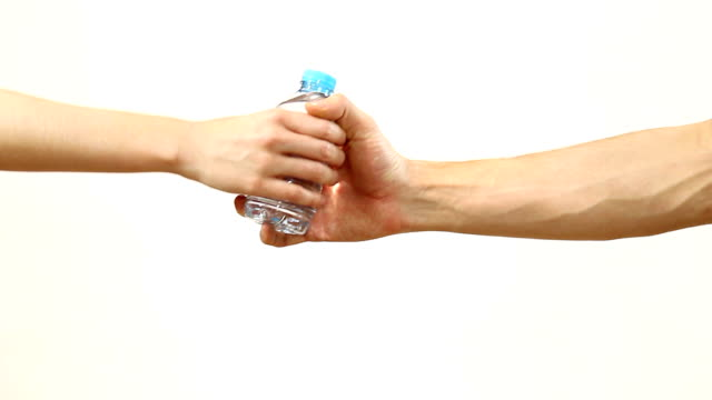 Woman hands bottle of water to man and vice versa