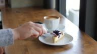 Woman Hands Cutting blueberry cheese pie with coffee at relax time , coffee cafe , dolly shot