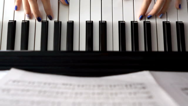 Woman Hands on Piano - Top view