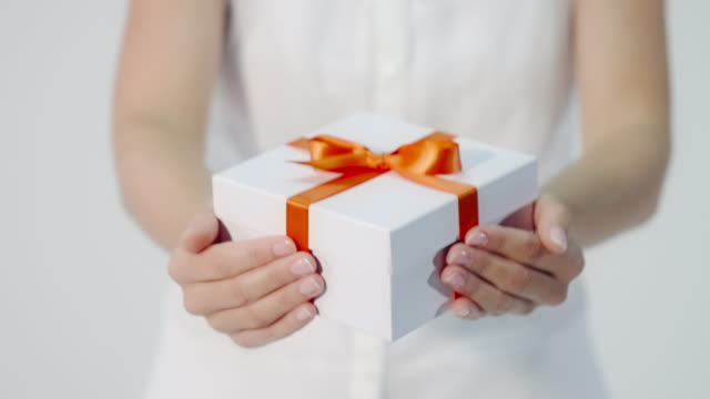 Woman hands over a gift