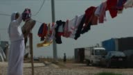 Woman hanging clothes in Yazidi refugee camp in northern Iraq For the approximately 20000 people living inside this refugee camp in northern Iraq...