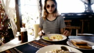 Woman have breakfast in cafe in Thailand
